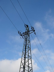 outdoor structure(0.0), mast(0.0), tower(0.0), electrical supply(1.0), overhead power line(1.0), line(1.0), transmission tower(1.0), electricity(1.0), sky(1.0), public utility(1.0),