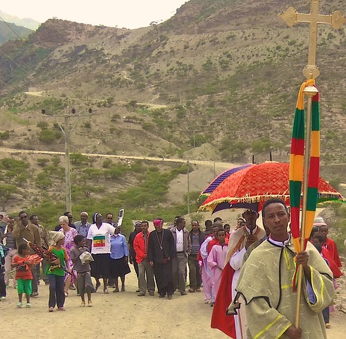 The procession continues towards the church in the village of Dawhan