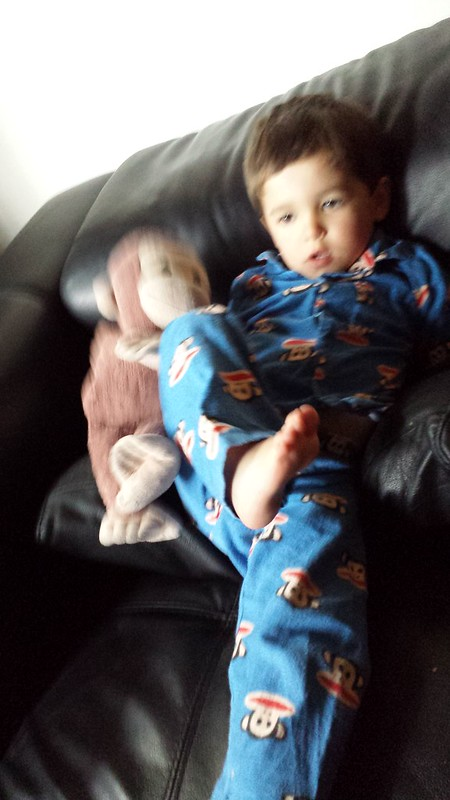 Eskil in his monkey pjs, holding Monkey