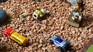 Toy cars on a grave