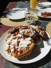 Yeasted cinnamon roll waffles, goat cheese frosting.