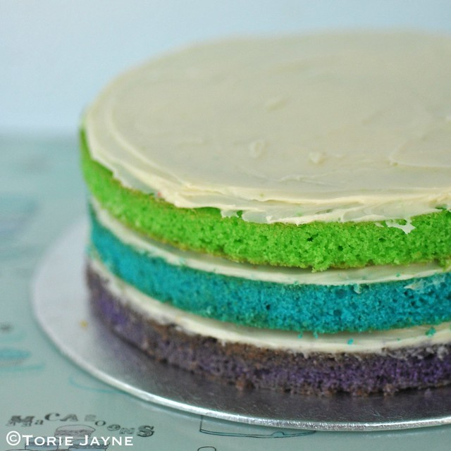 Stacking the rainbow cake 1