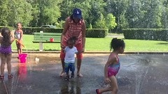 Running through the sprinklers with Grandma