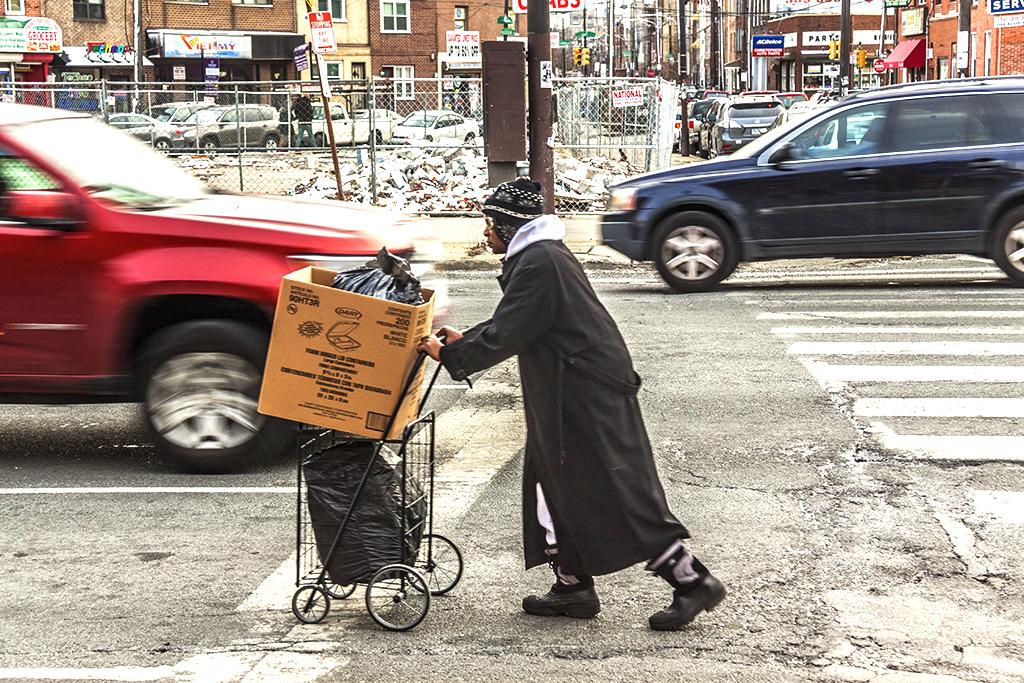 Man pushing cart down Washington Avenue--Italian Market