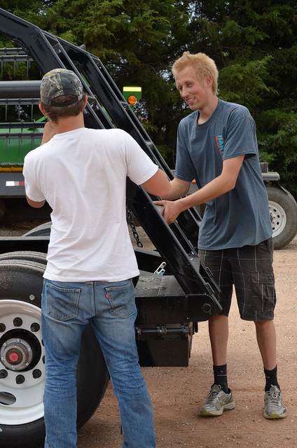 Martin helps Theo with the combine trailer ramps