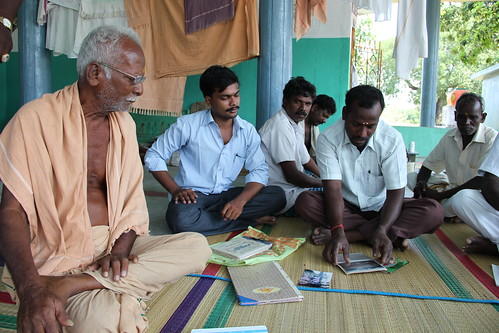 The Executive Committee of the Thalambedu Vayalagam meets outside a temple in the village