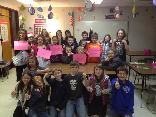 class with thank you signs