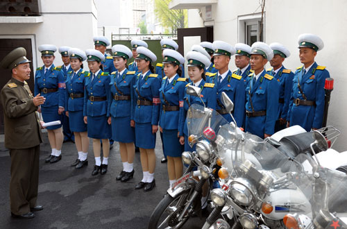 "PYONGYANG TRAFFIC GIRL AWARDED TITLE ""HERO OF THE DPRK"" 12058567603_f4847e4ccf_o"