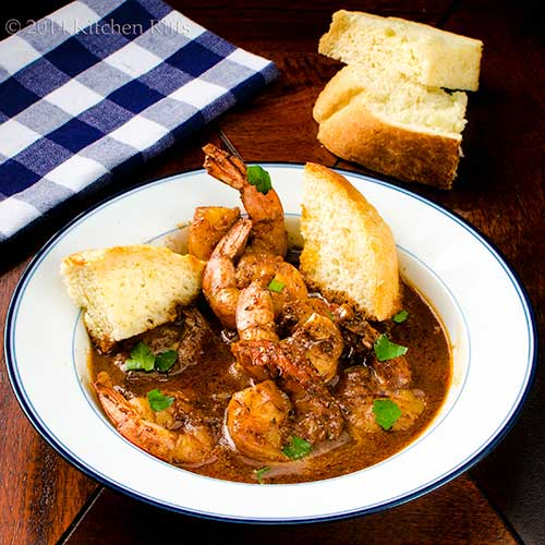 New Orleans Barbecue Shrimp in soup bowl with French Bread