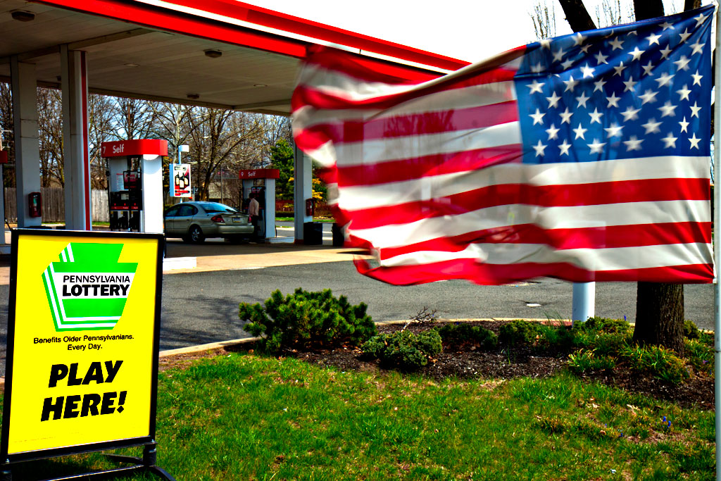 Flag-and-lottery-ad-at-gas-station--Bensalem-Township