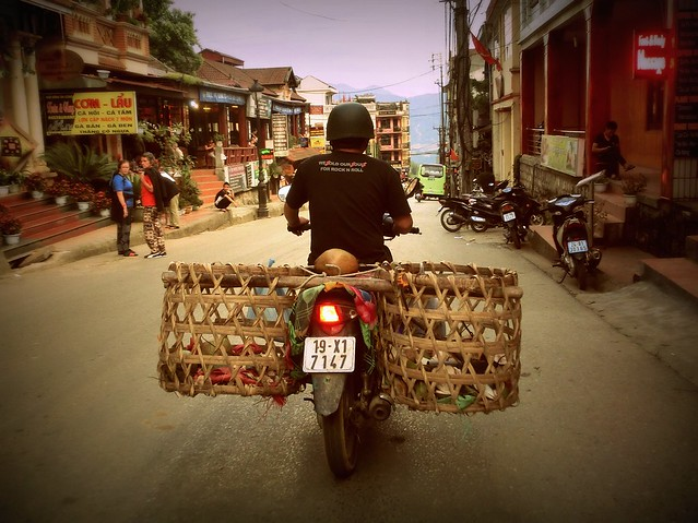 Baskets balanced on the back of a motorcycle in Sapa