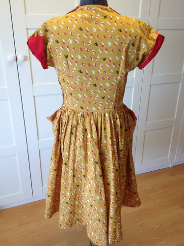 mustard bird dress back