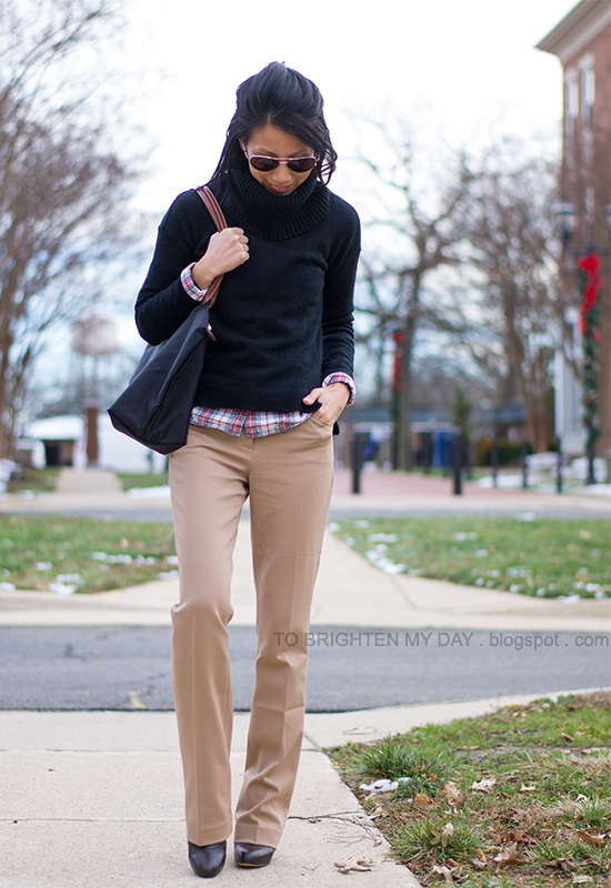 black cowlneck sweater, tartan shirt, camel trousers