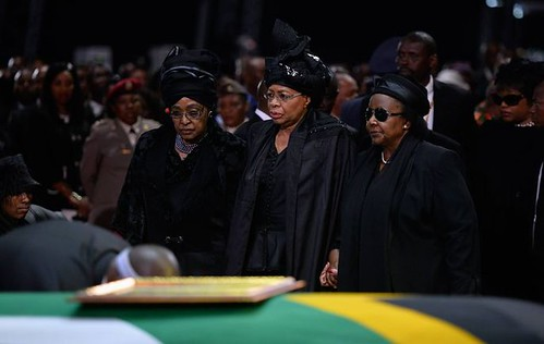 Winnie Mandela and Grace Machel at the funeral procession for former South African President Nelson Mandela on Sunday December 15, 2013. by Pan-African News Wire File Photos