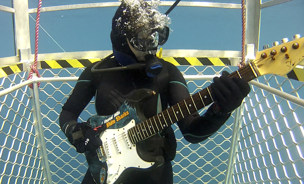 playing guitar underwater