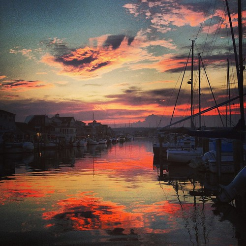 ocean sunset sky reflection water boats glp