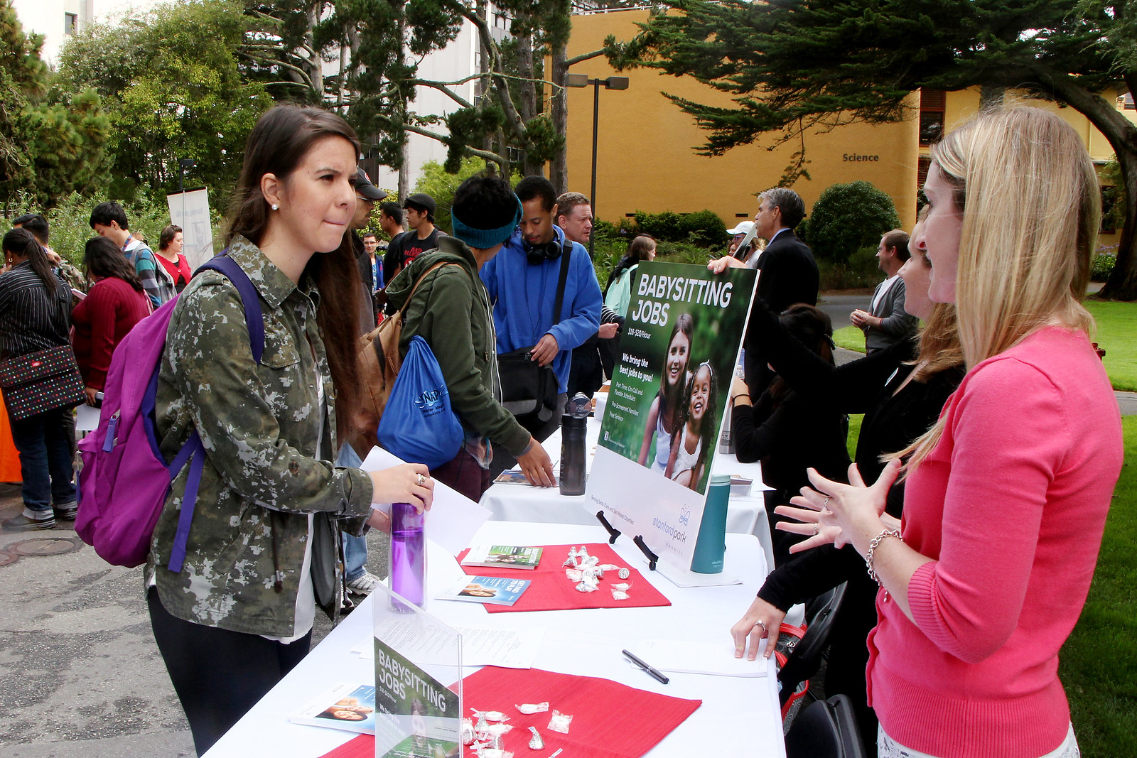 Valeria Hurtado, a Biology major, speaks to Sarah Boll, a representative of Stanford Park Nannies, at a Part-Time Job Fair held in the quad at SF State, on Sept. 12, 2013. The event was put together by the Student Involvement and Career Center as a for students to meet on and off campus employers offering part-time positions. Photo by Gavin McIntyre / Xpress