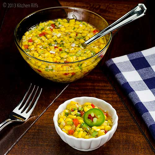 Quick Corn Relish in ramekin with serving bowl, fork, and napkin in background