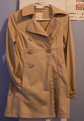shirt(0.0), pattern(1.0), brown(1.0), clothing(1.0), collar(1.0), sleeve(1.0), khaki(1.0), outerwear(1.0), overcoat(1.0), pocket(1.0), coat(1.0), trench coat(1.0),