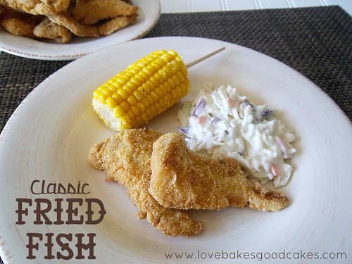 Classic Fried Fish with corn on the cob and cole slaw on plate.