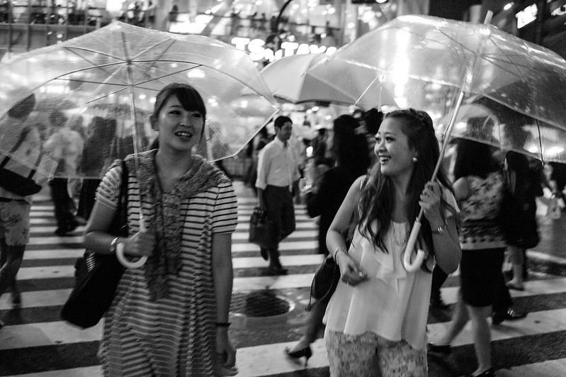 2 girls chatting in the rain at Shibuya Crossing, Tokyo
