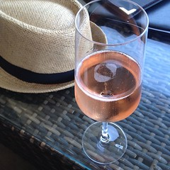 Final stop before the airport - pink fizz & my trip hat