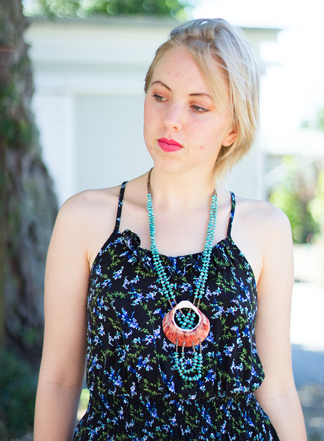 black and green floral sundress, turquoise and pink shell necklace
