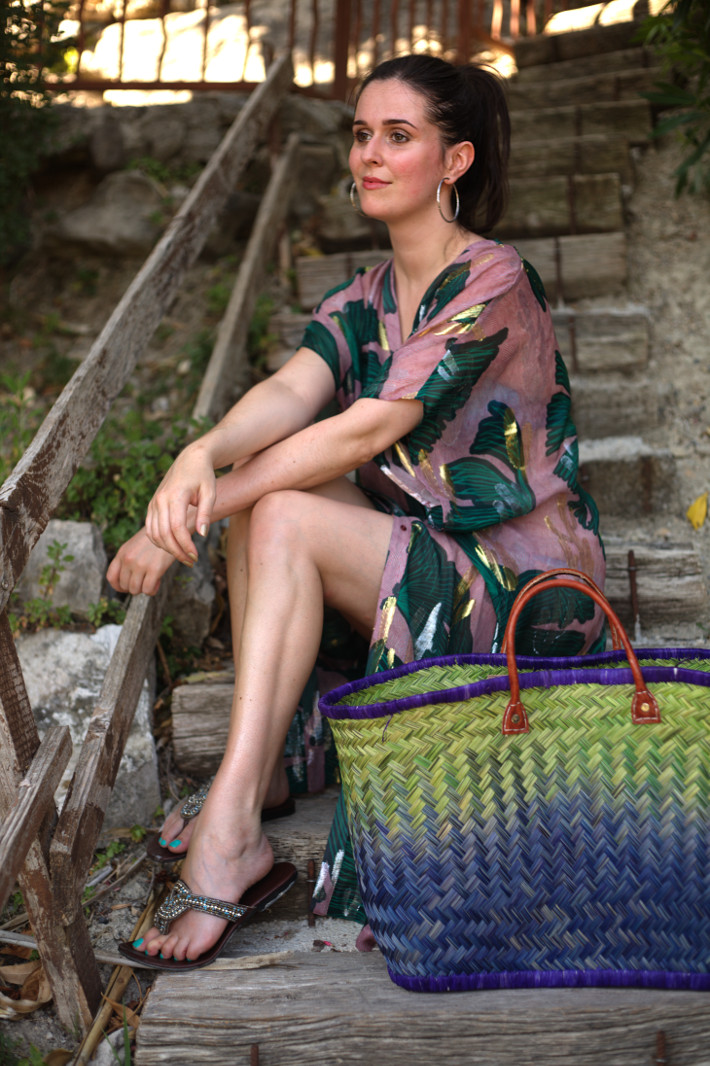 Outfit: silk kaftan, straw tote bag