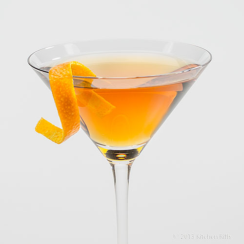 Bridal Cocktail in cocktail glass with orange peel garnish