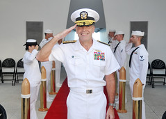"Rear Adm. Patrick Driscoll salutes during the playing of the ""Admiral's March"" before his retirement ceremony aboard the USS Arizona Memorial, June 20. (U.S. Navy Photo by Mass Communication Specialist 2nd Class David Kolmel)"
