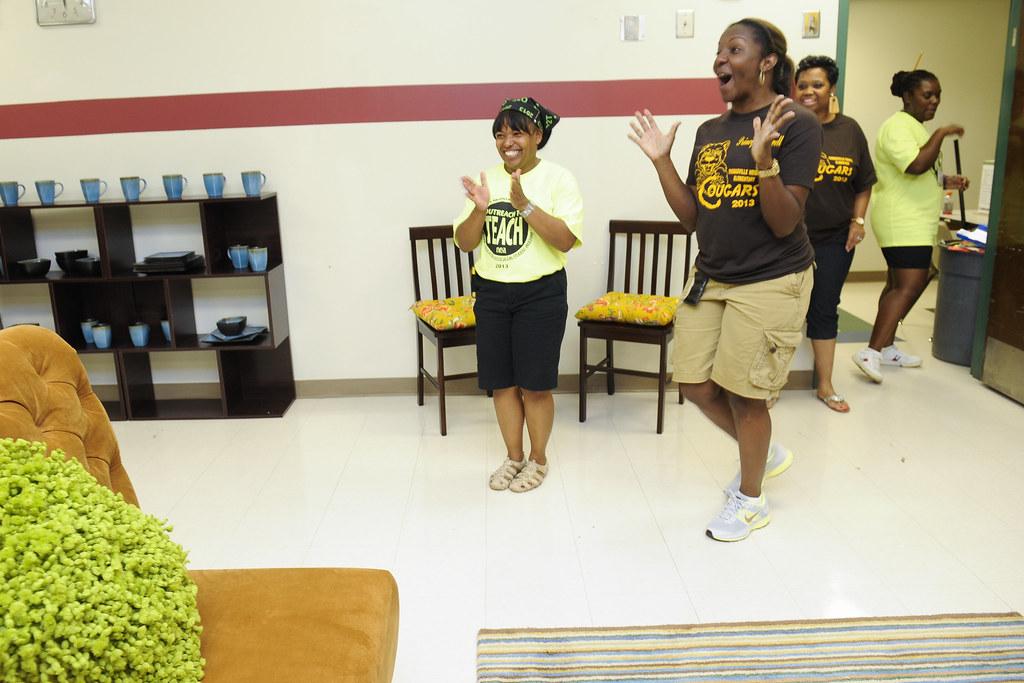 NEA | Principal Cynthia Jewell, right, reacts as she is show