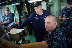 "Chief Gas Turbine Systems Mechanic Todd Furst, right, assigned to USS Freedom's (LCS 1) ""Gold"" crew monitors propulsion plant readings from the bridge with incoming ""Blue"" crew readiness control officer Chief Engineman Shannon Thomas., July 30. (U.S. Navy photo by Mass Communication Specialist 1st Class Cassandra Thompson)"