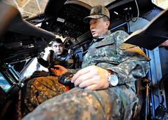Republic of Korea Navy Rear Adm. Kim Jongil, right, receives a brief inside an MH-60R Seahawk helicopter during a visit to Naval Air Facility Atsugi, Feb. 20. (U.S. Navy/MC2 Kegan E. Kay)