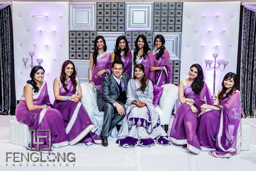 Bride and groom with bridesmaids at Ismaili Indian wedding on stage