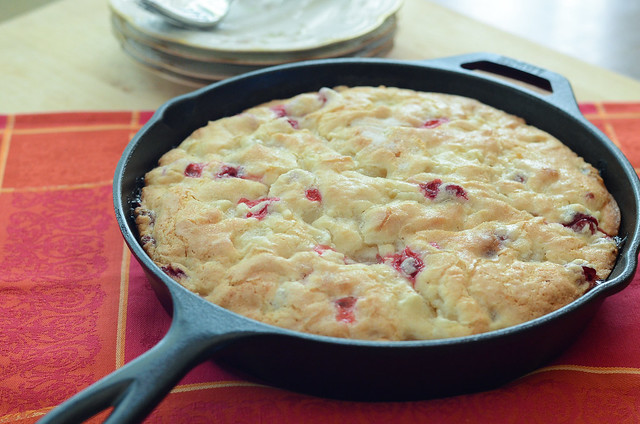 Cranberry Pear Breakfast Cake in a cast iron skillet.