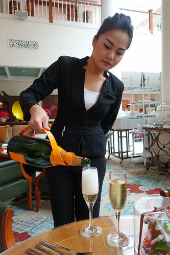 "VC Champagne being poured at Intercontinental Singapore during ""The Art of Sundays"" Champagne Brunch"