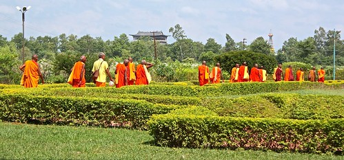 Buddhist monks exit the compound after the Chinese dignitary left