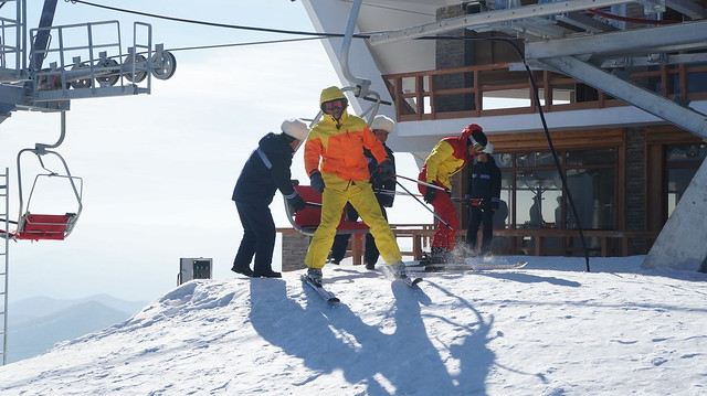 Getting off the ski lift at the Peak of Masik Pass