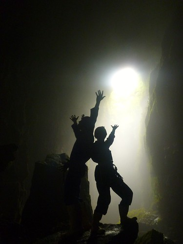 "striking a pose inside the ""Lost World"" cave"