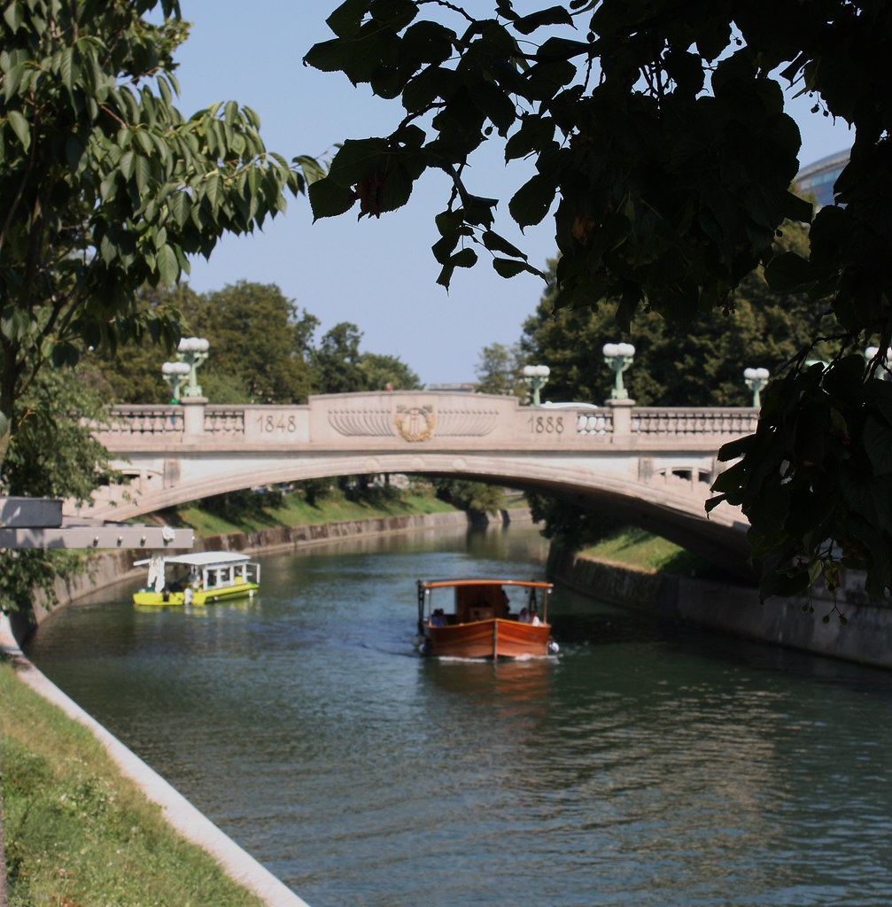 Two boats under bridge in Ljubljana Slovenia III