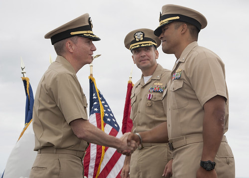 SAN DIEGO - Cmdr. Gervy J. Alota (right) shakes hands with Capt. Stephen McKone, Commander of Amphibious Squadron Five, after he takes command of USS Comstock (LSD 45) during a change of command ceremony held at Commander, Third Fleet Headquarters.