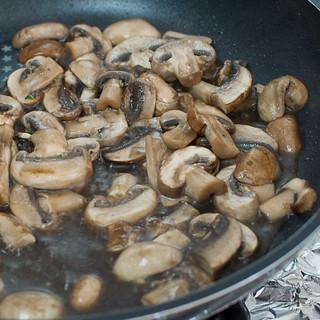 cook until mushrooms have reduced
