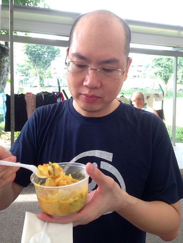 Ivan tucks in to lontong at the Assisi Hospice Charity Fun Day 2013