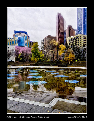 plaza city morning autumn trees canada west color colour reflection building tree calgary fall skyline buildings walking outside downtown cityscape exterior skyscrapers walk south noone ab nopeople canadian alberta highrise western olympic ornamental 2012 yyc iphone olympicplaza calgaryalberta calgaryab southernalberta canadiancity iphone4 calgarypictures skylinephotos picturesofcanada photosofcanada skylinepictures iphoneography canadianskyline calgarypubliclibraryphotographyclub iphone4s picturesofcalgary photosofcalgary picturesofalberta photosofalberta