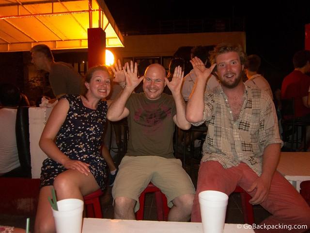 Playing drinking games at a dive bar