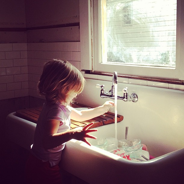 Amelia loves pretending to clean at the new sink (that now has running water!). I have to say I'm pretty excited about washing dishes tonight, too. Grateful for the luxury of water whenever we need it. #everydayfaves #kitchen #redo
