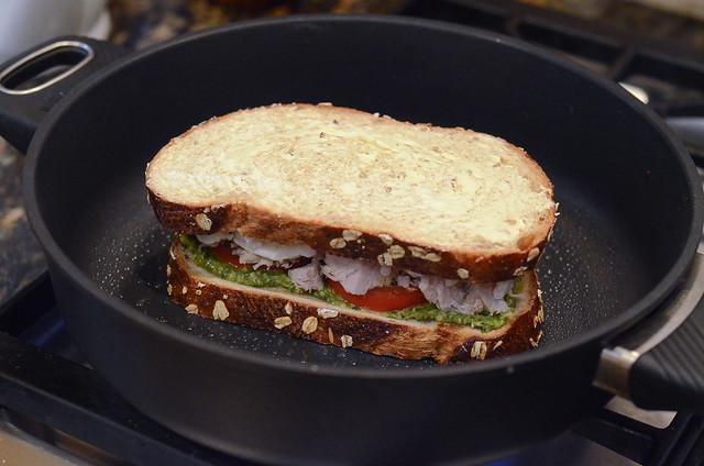 A sandwich in a skillet.