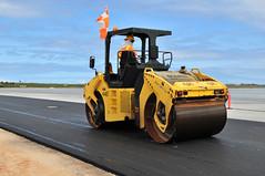 auto racing(0.0), forklift truck(0.0), asphalt(1.0), wheel(1.0), vehicle(1.0), transport(1.0), construction equipment(1.0), land vehicle(1.0),