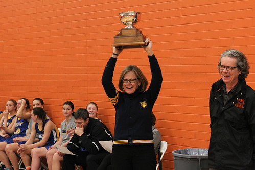 UBCO's Deputy Vice Chancellor and Principal Deborah Buszard raises Presidents Trophy (Women) (Snucins)