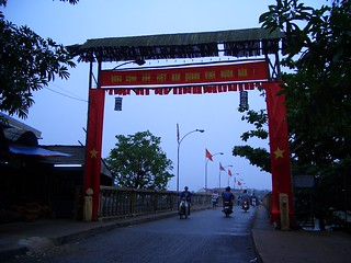 Bridge with banner and statues, Hoi An, Vietnam